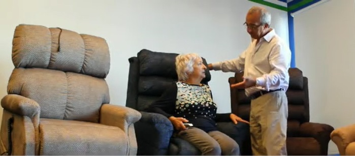 elderly woman on lift chair with sales representative